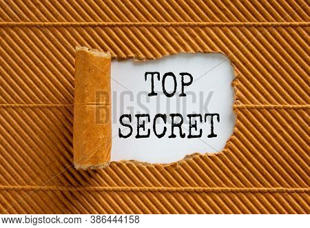 The Words 'top Secret' Appearing Behind Torn Brown Paper. Business Concept.