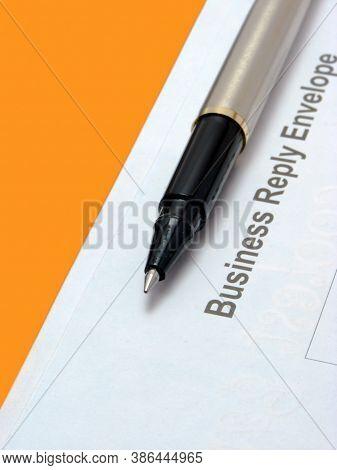 A Envelope & Pen Showing Text