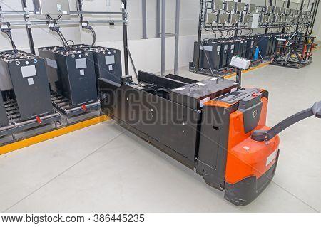 Pallet Jack Batteries Cart At Industrial Chargin Station