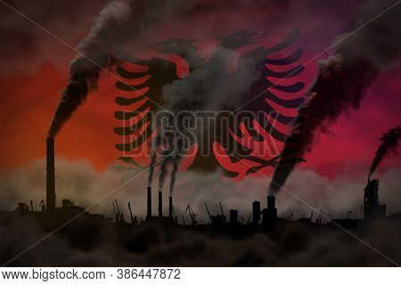 Dark Pollution, Fight Against Climate Change Concept - Factory Pipes Heavy Smoke On Albania Flag Bac