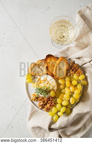 Plate With Roast Camembert And Slice Of Bread And Brunch Of Green Grape And Wine In Glass, Copy Spac
