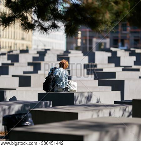 Berlin, Germany - September 18, 2020: Female Visitor At The Holocaust Memorial In The Centre Of Berl