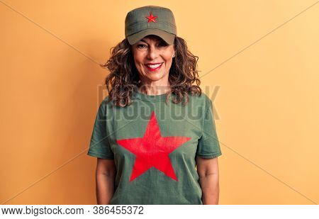 Middle age brunette woman wearing t-shirt and cap with red star symbol of communism with a happy and cool smile on face. Lucky person.