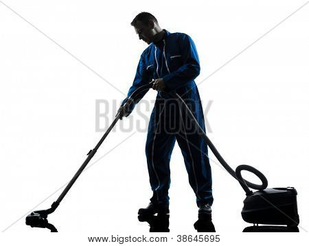 one caucasian janitor vaccum cleaner cleaning silhouette in studio on white background