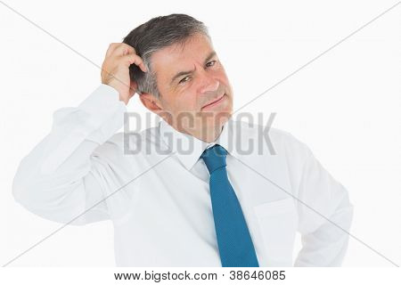 Puzzled businessman scratching his head