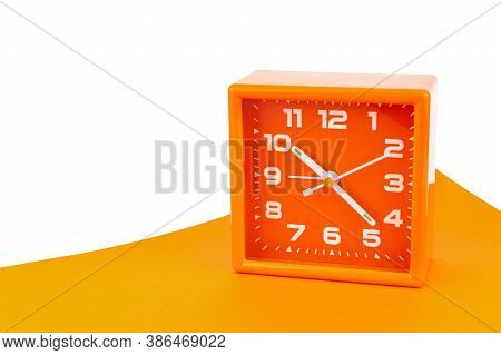 Orange Square Alarm Clock Isolated On White And Orange Background. Clock, Time, Dont Oversleep At Sc