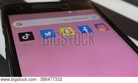Social Media Application Icons On Lg Nexus 5x Screen Close-up. Tiktok, Twitter, Snapchat, Facebook A