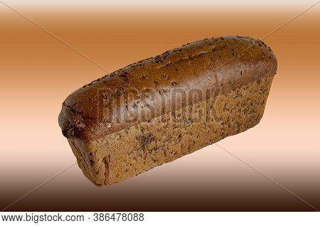 Loaf Of Rye Bread With Caraway Seeds On A Brown Background. Side View Of Freshly Baked Homemade Brea