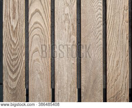 Brown Wood Planks With A Pronounced Wood Grain Pattern Are Laid Out In A Row. Five Boards Lie Side B
