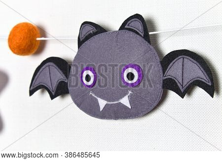 Felt Garland For Halloween. Wool Balls And Symbols. Frankenstein, Pumpkin, Ghost, Vampire And Voodoo