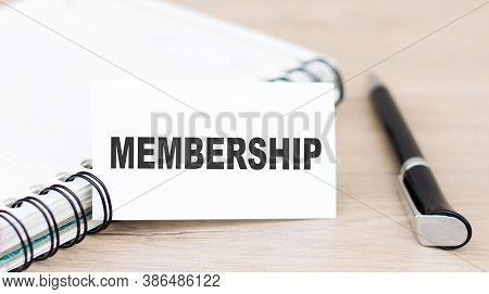 Membership. Text On A Card Next To A Notebook And A Pen On The Table