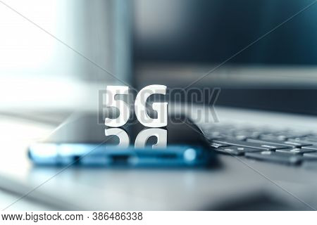 Mobile Phone, Smartphone With 5 G Wireless High Speed Internet. Creative Big White Letters 5G On Tou