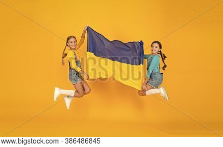 Patriotism Respect And Love To Motherland. National Identity Concept. Girls With Blue And Yellow Fla