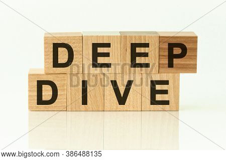 Modern Business Buzzword - Deep Dive. Top View On Wooden Table With Blocks.