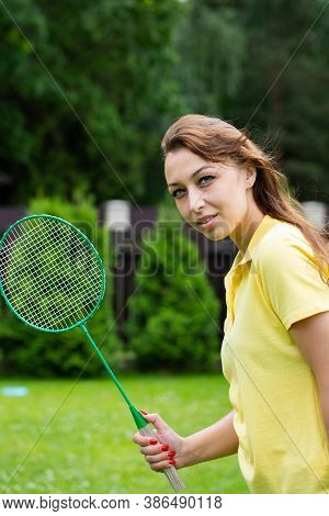 Portrait Of Female Badminton Player Holds Racket In Hands. Young Fit Beautiful Woman Playing Badmint