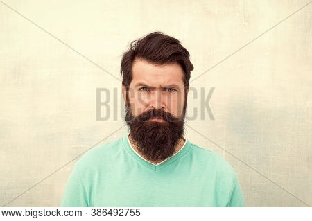 Strict Face. Perceptions Of Male Beauty Around The World. Man Bearded Hipster Stylish Beard Grey Bac