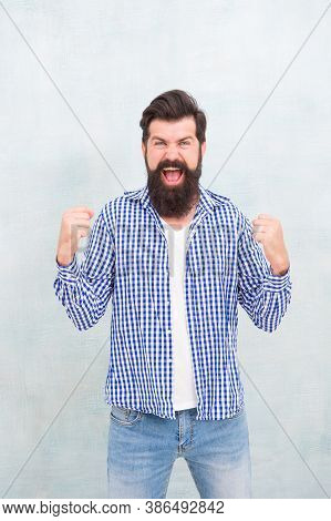 All It Takes Is All Youve Got. Happy Hipster Celebrate Victory Blue Background. Bearded Man Keep Arm