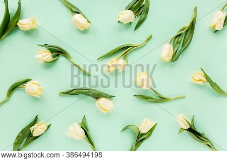 Floral Pattern Made Of Yellow Tulip On Green Background. Flat Lay, Top View. Valentines Background.