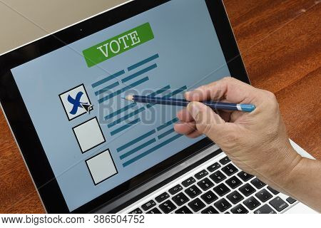 Person Voting On The Computer Over The Internet