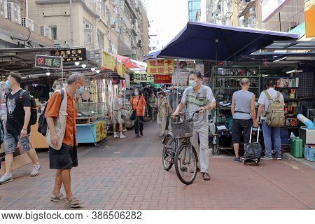 26 Aug 2020 People Wearing Face Masks Are Seen At Street Stalls