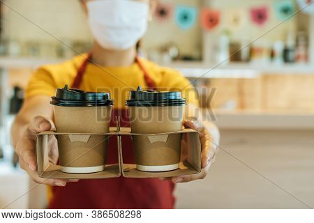 Take Away. Waitress Woman Wearing Protection Face Mask Waiting Serving Two Hot Coffee Cup To Custome