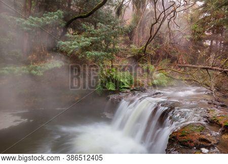 Thermal waterfall on Kerosene creek, Rotorua, New Zealand. Unusual natural landscapes