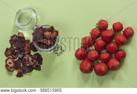 Dehydrated And Ripe Strawberries. Dried Sliced Berries Chips In A Glass Jar, Great Snack Without Art