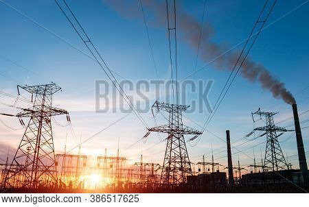 High Voltage Power Lines At Sunset. Thermal Power Plant. High-voltage Transformer Substation.