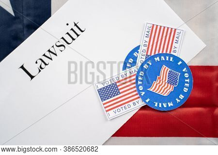 I Voted By Mail Stickers On Lawsuit Paper With Us Flag As Background - Concept Of Lawsuits In Usa El