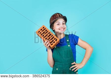 Labour Day. Little Girl Bricklayer. Learning How To Build. Little Worker In Helmet Building From Bri