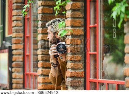 Photo Shooting. Brutal Man With Retro Camera. Professional Photographer Use Vintage Camera. Photogra