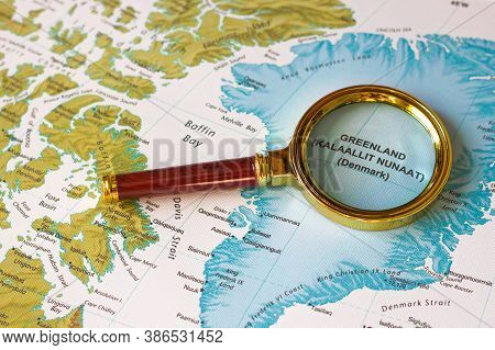 Magnifying Glass On A Map  Greenland And Islands Of North America, The North Sea, The North Ocean An