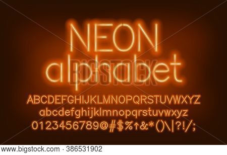 Neon Alphabet Font. Yellow Neon Light Uppercase And Lowercase Letters And Numbers. Blurred Backgroun
