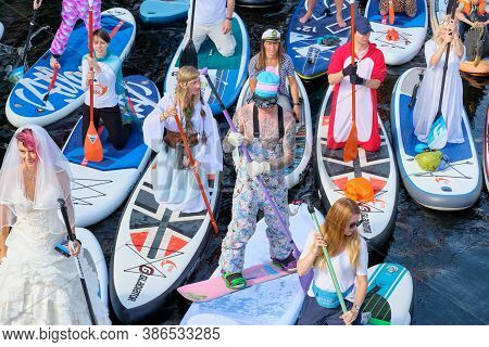 Russia, St.petersburg - August 8, 2020: Dressed Up Snowboarder At The Sup Surfing Festival.