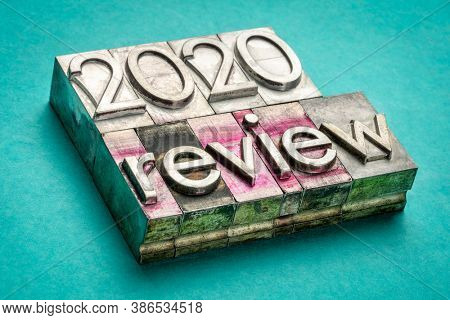 2020 year review word abstract  word abstract in gritty vintage letterpress metal types, business concept