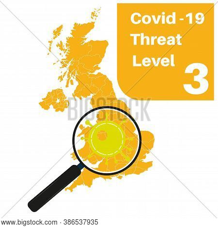 Covid-19 Uk Threat Level 3 (yellow) With Map And Magnifying Glass