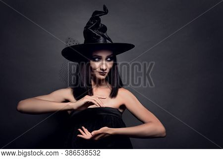 Mysterious Witch Wearing Hat On Black Background