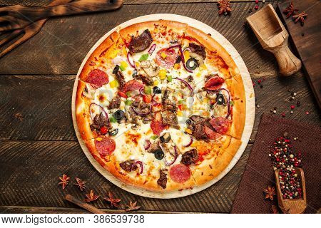 Top View On Assorted Beef Pizza With Salami And Vegetables