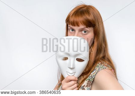 Mysterious Woman Cover Her Face Behind Anonymous Mask