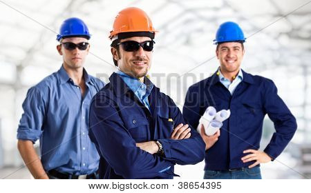 Group of handsome engineers at work