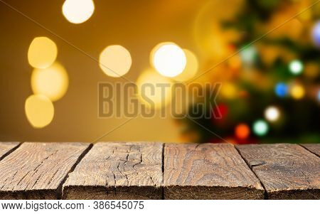 Christmas Empty Rustic Wooden Deck Table Over Christmas Tree And Blurred Light Bokeh. Fir Tree With