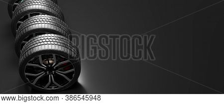 Wheels with modern alu rims on black background. 3D illustration