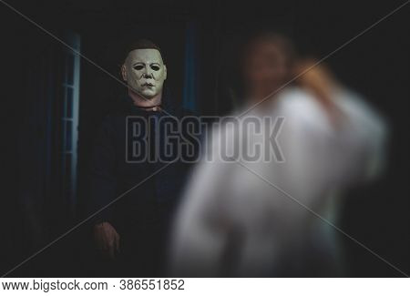 SEPTEMBER 20 2020: recreation of a scene from John Carpenter's Halloween, Michael Myers stalking  Annie Brackett - Neca action figure