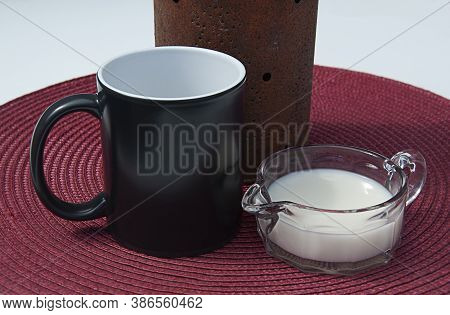 Black Coffee Cup Mockup With Cream On A Burgundy Placemat And Rustic Decor With Copyspace For Text O