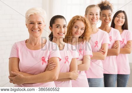Breast Cancer Campaign. Multiracial Women In Pink T-shirts With Awareness Ribbons Standing In Line O