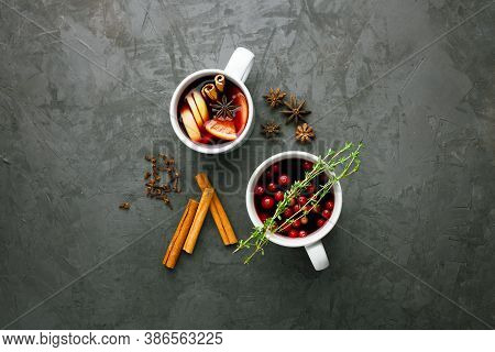 Christmas Hot Mulled Wine Drink In A Cups With Orange Citrus,apple,cinnamon Sticks And Stars Anise O