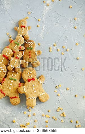 Christmas Pattern Of Biscuits Gingerbread Man Cookies On Light Blue Background Top View.festive Food
