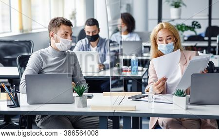 Social Distancing And Document Management During Coronavirus Outbreak. Millennial Guy And Lady In Pr