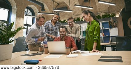 Business Professionals At Work. Multicultural Team, Group Of Young Cheerful Business People Analyzin