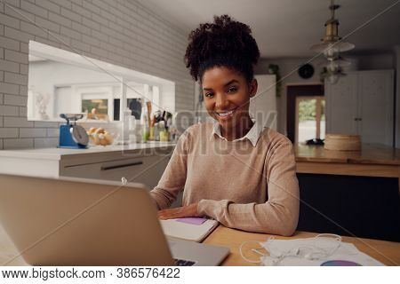 Student Studying And Learning Online With A Laptop In A Desk At Home During Coronavirus Pandemic Whi